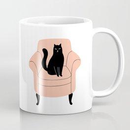 black cat on a chair Coffee Mug
