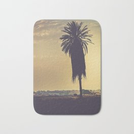 Andalusian sunset with silhouette palm tree. Retro toned Bath Mat