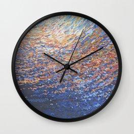 Illuminated Ocean Waves at Sunset Wall Clock