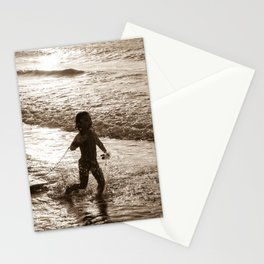 Little surfer girl runs in the waves with her bodyboard Stationery Cards