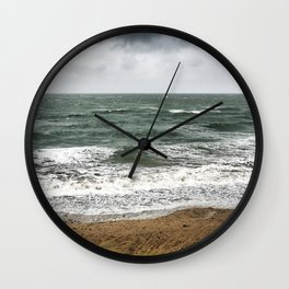 Land and sea under stormy clouds Wall Clock