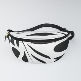 A white sheet of monstera on black background . Fanny Pack