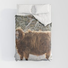 Funny Highland cow in the snow Comforters