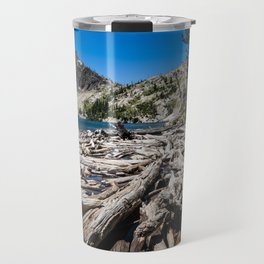 Sawtooth Lake in Idaho with lots of logs and driftwood in foreground Travel Mug