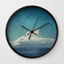 cloud over island Wall Clock