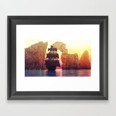 A pirate ship off an island at a sunset Framed Art Print