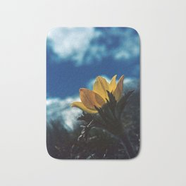 Touched by the Sun - Yellow Flower up in the Mountains Bath Mat