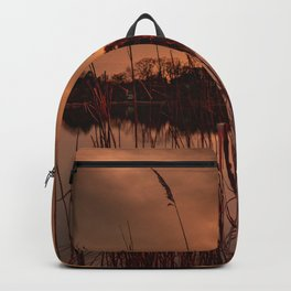 Hiding behind the bushes at sunset Backpack