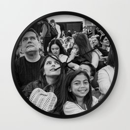 Family Watching an Event Wall Clock