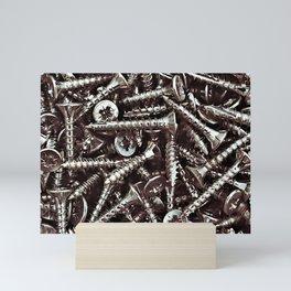 Group of  chrome steel screws close up. Mini Art Print