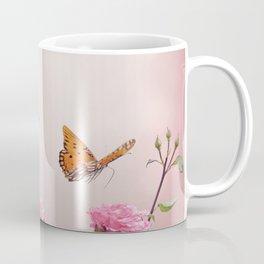 Gulf Fritillary butterflies feed in a rose garden Coffee Mug