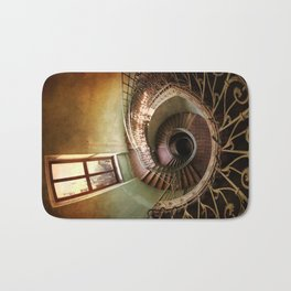 Spiral staircaise with a window Bath Mat
