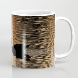 The silhouette of a duck in the river Coffee Mug