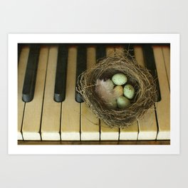Chocolate Eggs in a Birds Nest on a Vintage Piano. Art Print