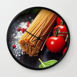 Spaghetti and tomatoes with herbs on an old and vintage wooden table Wall Clock