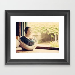 Woman in a Window Framed Art Print