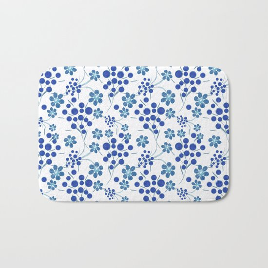 Blue flowers on a white background. Bath Mat