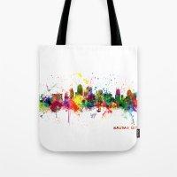 kansas city Tote Bags featuring Kansas City Skyline by artPause