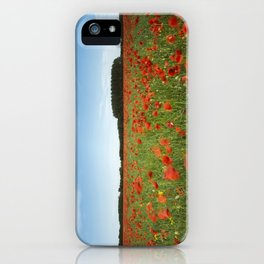 field of red poppies in evening light. Holme Hale, Norfolk, UK iPhone Case