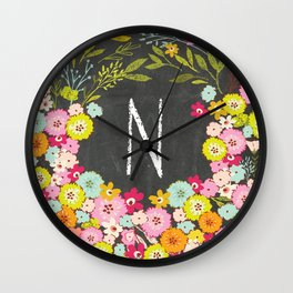 N botanical monogram. Letter initial with colorful flowers on a chalkboard background Wall Clock