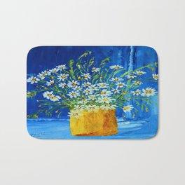 Daisies by the blue wall  Bath Mat
