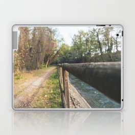 Irrigation ditch in the Ticino river natural park during winter before sunset Laptop & iPad Skin