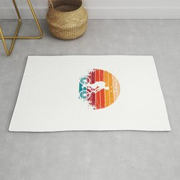 Cyclist Riding A Bicycle During Sunset Rug
