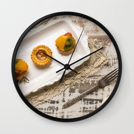Three fruit tarts presented on an elegant antique china plate Wall Clock