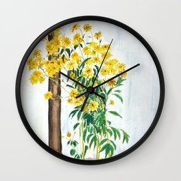 sun choke flowers outside a house Wall Clock