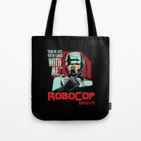 robocop Tote Bags featuring Robocop  by Buby87