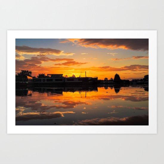 Sunrise arcross the water Art Print