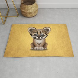 Cute Cougar Cub Wearing Reading Glasses on Yellow Rug