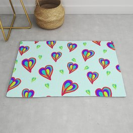 Rainbow Hearts: a fresh, colorful pattern of hearts floating on air, on a pale turquoise background Rug