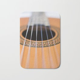 Strings of the guitar above the rose window Bath Mat