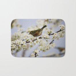 A Bird Perching on a Twig Bath Mat