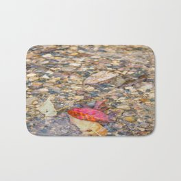 Red Leaf Stuck Among Watery Rocks Bath Mat