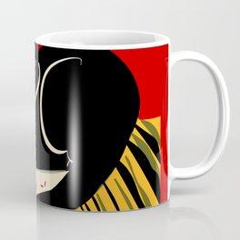 Black cat on a striped cushion Coffee Mug