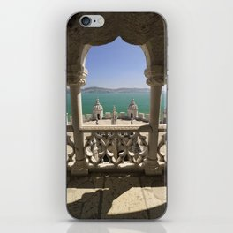 The Torre de Belem tower, view through arches to the river Tejo, Lisbon, Portugal iPhone Skin