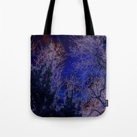 psychadelic Tote Bags featuring Psychadelic trees frame the moon by Cheryl - DevilBear Photography