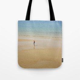 A Man on La Concha Beach in San Sebastian, Spain Tote Bag