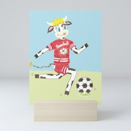 Snowbell the cow plays soccer Mini Art Print