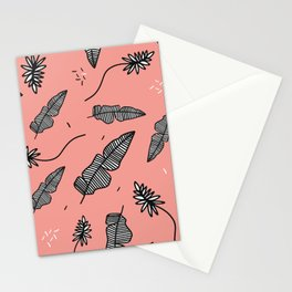 Palm branches. Palm leaves on a pink background. Summer mood. Stationery Cards
