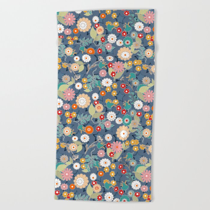 Colorful flowers on a denim background. Beach Towel