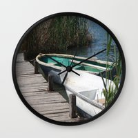rowing Wall Clocks featuring Reeds, Rowing Boats and Old Jetty at Dalyan by taiche