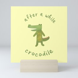 After a While, Crocodile: Cute Minimalist Croc Illustration with Lettering, Green on Pastel Yellow Mini Art Print
