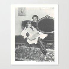 Kareem Abdul Jabbar hiding behind a little girl reading a book on a sofa Canvas Print