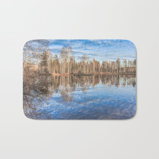 Sky reflection in a spring pond Bath Mat