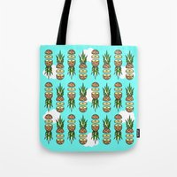 pinapple Tote Bags featuring Eat pineapples by Jan Luzar