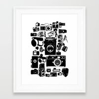 cameras Framed Art Prints featuring Cameras by Ewan Arnolda