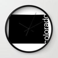colorado Wall Clocks featuring Colorado by Isabel Moreno-Garcia